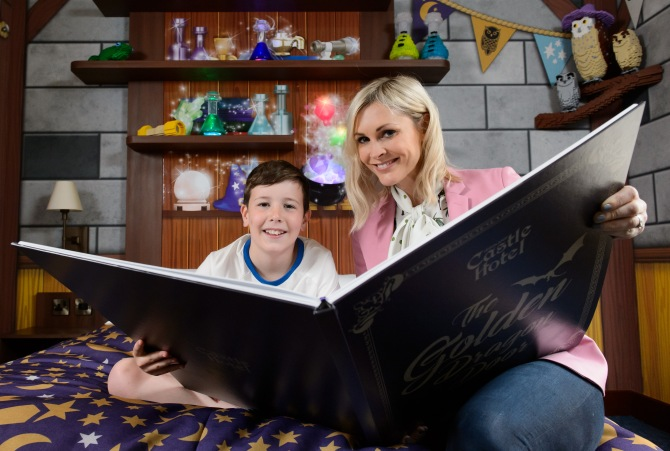 Jenni Falconer presents Joseph Parkes (10) with a giant copy of the bedtime story he wrote to launch LEGOLAND® Windsor resorts new Castle Hotel. UK